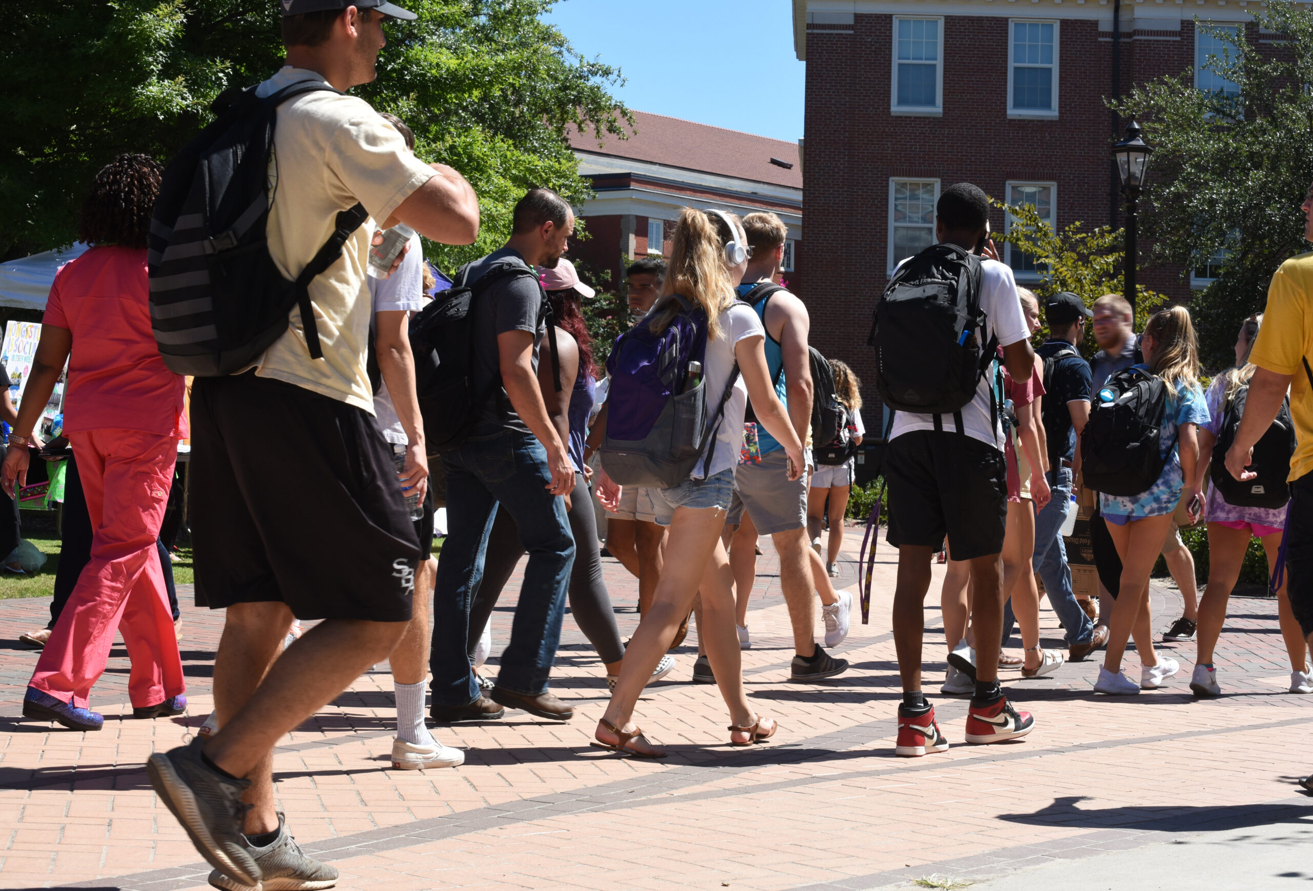 College students walking across campus
