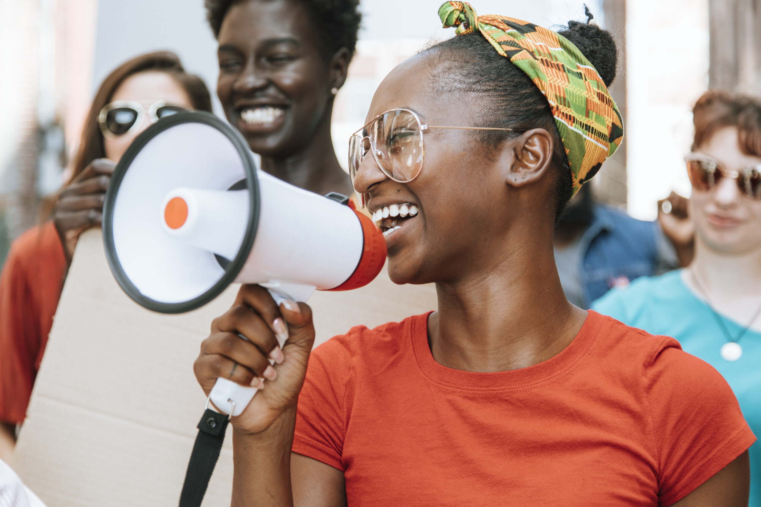 Smiling demonstrator with megaphone