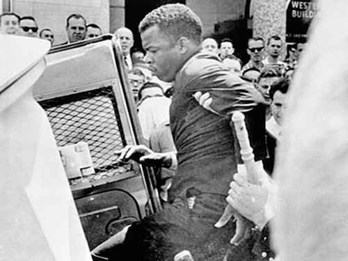 John Lewis getting arrested in Nashville, Tennessee. Photo from New Georgia Encyclopedia.