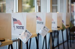 A row of voting booths stock image for systemic equality webpage.